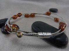 guitar string bracelet- great re-purpose for broken strings
