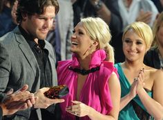 Pin for Later: Carrie Underwood and Mike Fisher Are Already the Most Adorable Parents  Carrie shared her excitement with Mike at the 2010 CMT Music Awards in Nashville.