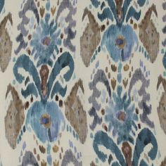 Pandora Ikat Fabric A striking linen fabric with a beautiful ikat design in blue and brown.