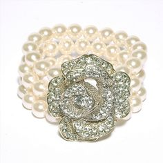 Three rows of synthetic pearls with a diamante studded rose feature.    Price: £35.00 inc VAT       www.onyxx.co.uk