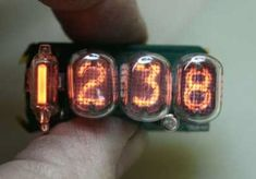 New nixie tube watch… Nixie Tube Watch, Cool Watches, Watches For Men, Steampunk Mask, 2d Art, Ham Radio, Retro Futurism, Made Goods, Digital Watch
