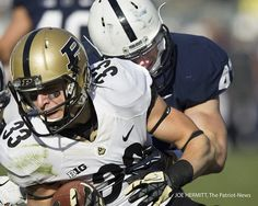 PENN STATE – FOOTBALL 2013 – Penn State linebacker Mike Hull hauls down Purdue wide receiver Danny Anthrop during the Lions' win last season. Football 2013, Football Season, College Football, Football Helmets, Pennsylvania State University, Wide Receiver, Knee Injury, Athletics