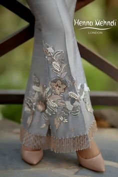 Grey raw silk boot cut trousers with pearl and crystal embroidery and embellishment with crystal hangings. Available to order as boot cut or straight trousers. Desi Wedding Dresses, Pakistani Wedding Outfits, Simple Pakistani Dresses, Pakistani Dress Design, Salwar Designs, Stylish Dresses, Casual Dresses, Embroidery On Clothes, Lace Dress With Sleeves