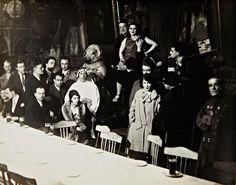 Au Cabaret du Ciel, Paris, 1927. Man Ray The cabaret scene shown in the current lot was intended for reproduction in Variétés, a Belgian publication dedicated to Surrealism. Hans Arp, Jean Caupenne, Georges Sadoul, André Breton, Pierre Unik, Yves Tanguy, Cora, André Thirion (shown from behind, facing Cora), René Crevel, Suzanne Musard, and Frédéric Mégret (shown with cigarette). Seated at the front of the table are Elsa Triolet, Louis Aragon, Camille Goëmans, and Madame Goëmans.