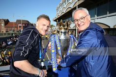 <a gi-track='captionPersonalityLinkClicked' href=/galleries/search?phrase=Jamie+Vardy&family=editorial&specificpeople=8695606 ng-click='$event.stopPropagation()'>Jamie Vardy</a> of Leicester City and manager <a gi-track='captionPersonalityLinkClicked' href=/galleries/search?phrase=Claudio+Ranieri&family=editorial&specificpeople=204468 ng-click='$event.stopPropagation()'>Claudio Ranieri</a> of Leicester City pose with the trophy during the Leicester City Barclays Premier League Winners Bus…