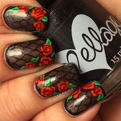 Red Rhodes & black trellis nail art using   stamping @mundodeunas Black and @uberchicbeauty 4-03 on nails then adding 2 layers of @ellageepolish Black Licorice Marmalade. Next, outlined  nails with @colorclubnaillacquer Where's The Soirée then used a few MdU for the roses and sealed it all with top coat
