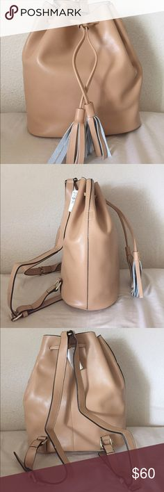 Genuine Leather Nude Bucket Bag Backpack Completed unused leather bucket backpack that is SO in style right now in a gorgeous and versatile nude color. Inner lining is a light grey suede and the bag itself has a removable zippered compartment inside! Feel free to make an offer below! Neiman Marcus Bags Backpacks