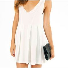 White low cut dress This low cut white pleated dress was worn once for a sorority recruitment. Very flattering and stretchy material. Dresses Mini