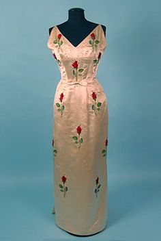 Embroidered satin evening gown with rhinestone embellishment, by Pierre Balmain, French, spring 1955.