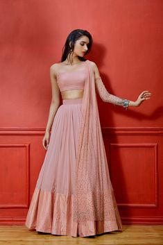 Salmon one cold shoulder net and georgette based blouse with embellished sleeve and attached dupatta. Featuring a georgette lehenga with silk pintucked border. Half Saree Designs, Lehenga Designs, Saree Blouse Designs, Lengha Design, Dress Indian Style, Indian Dresses, Indian Wedding Outfits, Indian Outfits, Indian Designer Outfits