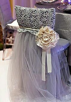 In white with tiffany blue, add hanging crystals and brooch