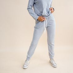 An ethically-made jogging pant does exist. The Fair Jogger features a flattering relaxed fit, ankle cuffs, two pockets, and an adjustable drawstring waist. Breathable, but cozy. Soft and sustainable. You can truly have a jogging pant that does it all. Pair with the Fair Hoodie to create a Fair Jogger Set. Note: This fabric will shrink during the first wash - but we've accounted for this! If your joggers feel a bit big on arrival, just wash them, and lay flat to dry. Do not put it in the… Winter Wardrobe Essentials, Joggers Womens, Ethical Clothing, Drawstring Waist, Dryer, Jogging, Cotton Spandex, Winter Outfits, Heather Grey