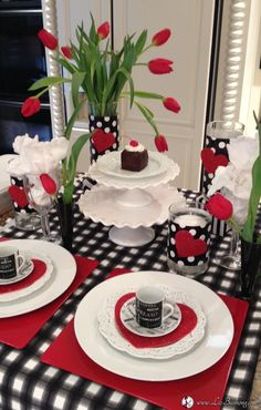 Valentine Tablescape|www.lizbushong.com Black, White and Red Tulips set the scene for an easy table setting. White dinner ware, cake stands and Black Forest Mini Cakes for the Dessert Centerpiece.