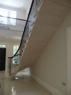 stone staircase in contemporary country house. Ascot. www.thestonemasonrycompany.co.uk