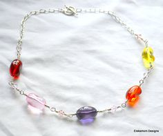 Jellybeans necklace with glass jellybeans and pink Swarovski crystals by Eleksmom Designs.