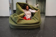 a sofa/chair that has a built in blanket! awesome! it is like it has a built in nap :)