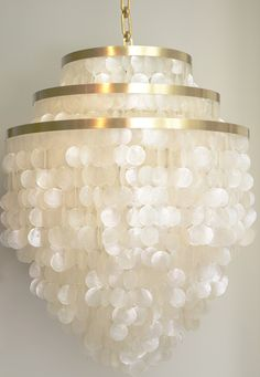 Quite simply the most luxe, lush and versatile capiz chandeliers available. This classic design staple can be made to almost any size and shape. Enough polish for a chic city apartment, or play up the organic materials at the beach or in the country.
