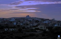 Elata . Chios island . Sunset in Elata.The village with the stone houses and the small towers of the castle which has been preserved through the centuries. It is worth visiting the stone-built church of the Holy Trinity and the 16th-century murals in the church of St. John.
