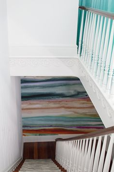 The stripes on this wall look almost like wood grain.  The turquoise in the upstairs hallway is so beautiful.
