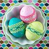Dyed Lace-Wrapped Easter Eggs: For a pretty two-tone egg embellishment, add a band of lacy fabric to match the colour of your dyed egg. Cut the fabric to fit the egg (you'll need about 3-4 inches, depending on the size of your egg) and secure each end with a dab of hot glue.