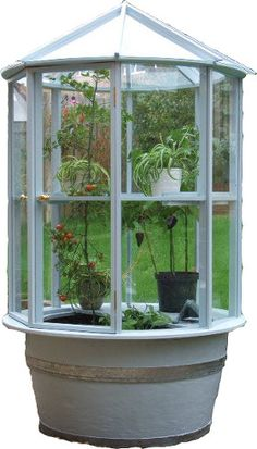 REcycled Greenhouse....all recycled materials....I like it