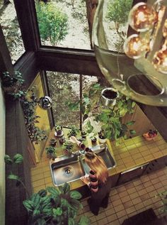 8 Ideas Worth Stealing from Vintage Kitchens | Apartment Therapy ... The yellow tile in this 70s kitchen, spotted on Dry Dock Shop, may not be something that modern homeowners are eager to repeat, but I'd take a TWO-STORY WINDOW ABOVE THE SINK any day.
