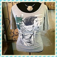 """Zara Collection HTF Graphic Girl Words & #'s Top This is rare gem of a tee/top. A graphic collage of the girl, poetry, math & Japanese characters. Soft heather gray, green, black, white colors. Still in very good condition. Sleeves are a tad longer than standard """"short"""" sleeves. Measurements: Bust=36"""", Shoulder width seam to seam=16"""", Length from shoulder to hem=23"""". Size Lg but runs closer to a Med in my opinion. There is subtle pilling in certain spots but not noticeable unless looking…"""