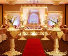 Notice how just using cream and gold decor for the wedding venue makes it look so incredibly royal. #desi #indian