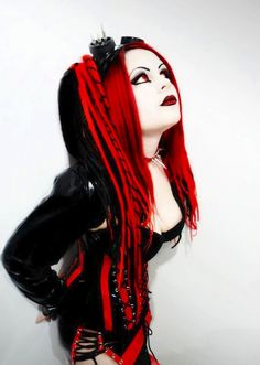 Red and black cyber goth, and I really like this one! The makeup and falls are great! And the colors really make it pop.