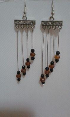Orecchini con perline nere e pietre color ambra