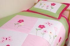 Lily Bedspread and Pillowsham  This brightly coloured quilted throw and pillowsham looks beautiful in a girl's bedroom. The cheerful pink gingham, white and colourful floral designs are surrounded by a lime green and deep pink border on both the pillowsham and the quilt cover. The lovely embroidered flowers and butterflies on this bedspread are coloured in pale pink and white gingham, yellow, green and deep pink. Matching duvet cover set also available. | Childrens Bed Centres