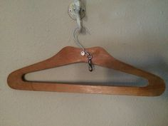 Wooden hanger with clip.