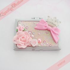 This listing is for a super kawaii handcrafted decoden compact mirror fit for a princess! The iridescent pink sequined cover is embellished with elegant roses, a pretty pink bow, white rhinestone studded crown, and sparkly rhinestones & pretty pearls.   Perfect for doing touchups throughout the...