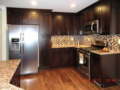 Dark Brown Varnished Wooden Oak Kitchen Cabinet