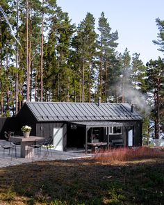 This modern sauna is located in Raasepori, Finland. It is designed by Sunhouse architects - Kalle & Inga Oikari. Modern Barn House, Modern House Design, Modern Saunas, Summer House Interiors, Metal Roof Colors, Natural Swimming Pools, Natural Pools, Outside Room, Cabin Design