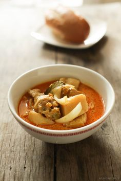 A bowl of Vietnamese chicken curry, with onion and potatoes