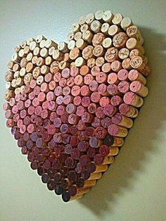 These corks were not painted. They are different hues of red because of the wine that was in the bottle.