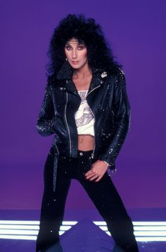 Cher 1980's I Paralyze photo shoot...wearing the all seeing eye t-shirt and pyramid between her legs.