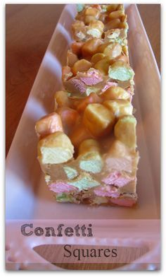 Confetti Squares ~ Just a little melting of butter, peanut butter and the chips, then letting the mixture cool a bit. Stir in marshmallows, put them in a pan, toss in fridge and you are done! Older Mommy Still Yummy Candy Recipes, Sweet Recipes, Baking Recipes, Cookie Recipes, Dessert Recipes, Kraft Recipes, Just Desserts, Delicious Desserts, Yummy Food