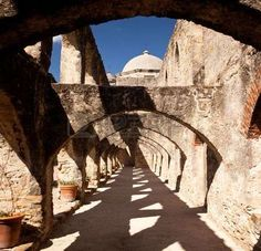 san antonio missions: View of the arches leading to the San Juan Mission in San Antonio Stock Photo