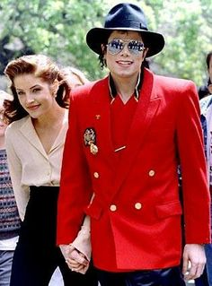 Michael Jackson and Lisa Marie Presley.. Beautiful couple but I don't think Lisa loved Michael as much as he loved her..