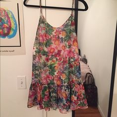 Muui brand Springtime Dress Super adorable floral print dress! Low back. Bought from Australia so it says size 10 but that converts to a 6 in US. Looks adorable with white sandals or some wedges! Lightly used but I haven't worn in forever. Let's give this dress a new home :) LF Dresses