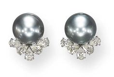 A PAIR OF GRAY CULTURED PEARL AND DIAMOND EAR CLIPS   Each set with a gray cultured pearl measuring approximately 15.20 mm, enhanced by a pear-shaped diamond surround, mounted in platinum