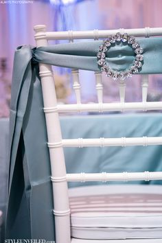 Jeweled blue sash on a Chivari chair // Photographer: Alante Photography //  Design and Rentals: Grand Event Rentals // Floral Design: Rented Elegance