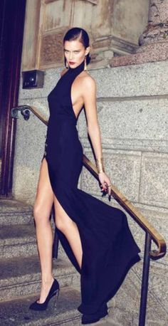 she's glamorous in black evening gown slit up to there