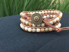 This 3-wrap bracelet is 6mm Picture Jasper on natural brown leather. Adjustible - 21, 22, and 23 inches.
