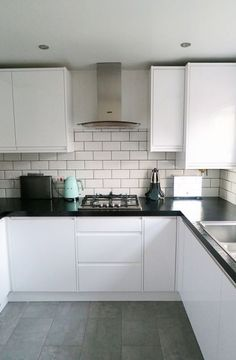 Our new kitchen which we designed with Wickes. I love the white gloss, mint SMEG accessories and subway tiles. White Gloss Kitchen, White Kitchen Cabinets, Kitchen Cabinet Design, Kitchen Tiles, Kitchen Flooring, Kitchen Interior, New Kitchen, Kitchen Decor, Kitchen Splashback Ideas