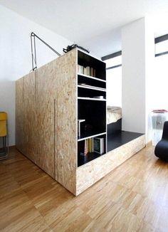 francesca perani . Estructura de cama en osb con escalón y libreria.