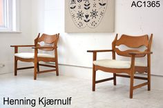 rare pair of oak armchair designed by Henning Kjærnulf. £1595 each