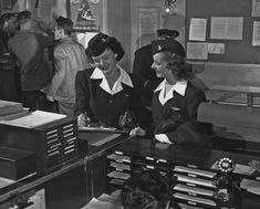 These two flight attendants are checking in before a flight on a Douglas DC-4 in 1955